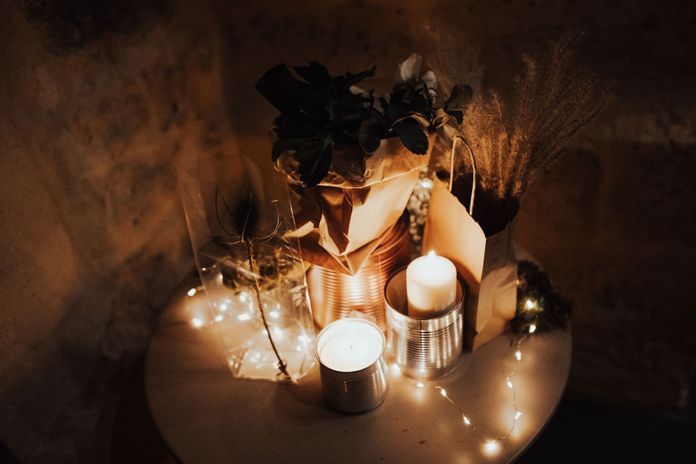 candles and floral offerings