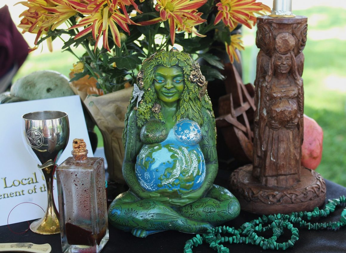 Pagan altar, goddess with candle and flowers
