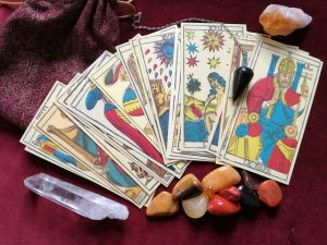 tarot cards with crystals and pendulum